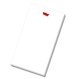 Notizblock mit lüttem Papierboot